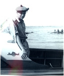 1963 Scotch College Cadet and N.C.O student taking part in a training drill on a boat on the Swan River