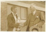 1932 Headmaster Peter Corsar Anderson congratulating Captain of Cricket