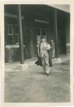 1940s Headmaster Peter Corsar Anderson walking the Senior School campus