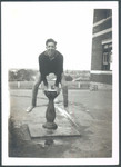 1940-1950s Student jumping over the Senior School Water Fountain
