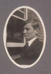 1925-1928 Student outside facing wall at M-Block Building