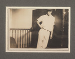 1925-1928 Student in Cricket Team uniform upstairs at the M-Block Building Dormitory