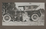 1919 Geoffrey Maxwell OSC1918 (far right) and suited men on automobile
